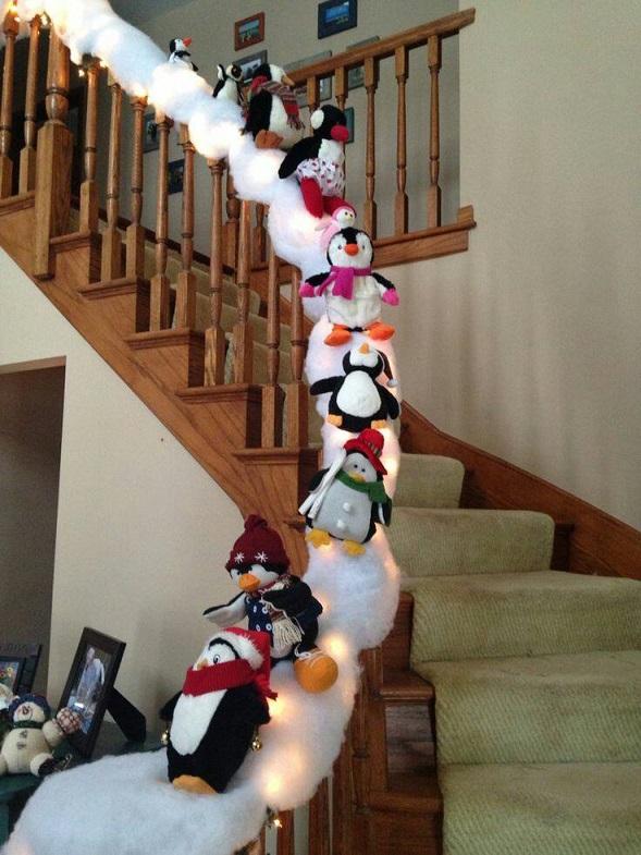 sliding-penguins-stair-railing-christmas-decor