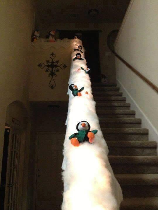 sliding-penguin-christmas-stair-railing